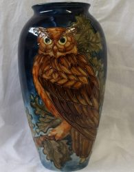 Lot 204 - Sold for £490 - A Moorcroft pottery vase decorated with an eagle owl, acorns and oak leaves to a dark blue night sky with crescent moon, impressed and painted marks, limited edition No 273/500, 32cm high