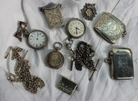 A George V Silver vesta case decorated with scrolling leaves, Birmingham, 1910, together with other vesta cases, watch chain, fob watches etc approximately 179 grams. Sold for £370 at Anthemion Auctions