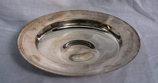 """An Elizabeth II silver """"Armada dish"""" of circular form London, 1971, Richard B Wigfull & Son Ltd, approximately 279 grams, 17.2cm diameter. Sold for £120 at Anthemion Auctions"""
