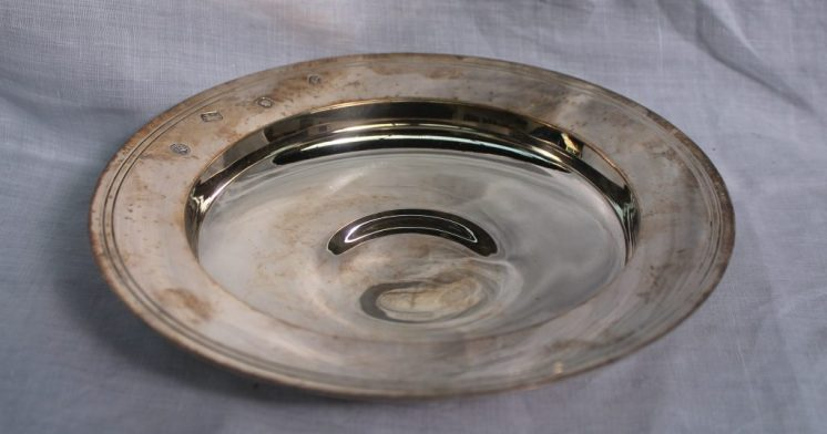 "An Elizabeth II silver ""Armada dish"" of circular form London, 1971, Richard B Wigfull & Son Ltd, approximately 279 grams, 17.2cm diameter. Sold for £120 at Anthemion Auctions"