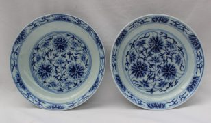 A pair of Chinese porcelain shallow dishes painted with flowers and leaves in blues, six character mark to the base, 15.5cm diameter. Sold for £2,600 at Anthemion Auctions