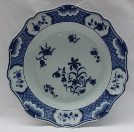 Chinese blue and white porcelain bowl, with a raised leaf border, painted with vignettes of flowers, the centre painted with flowers. Sold for £35 at Anthemion Auctions