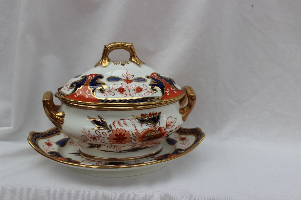 A Swansea porcelain sauce tureen, base and cover in set pattern No. 264, decorated with flowers and leaves in reds, blue and gold, base 21cm wide x 15cm deep this is a rare shape. Lot 281 in our February 21st Fine Sale
