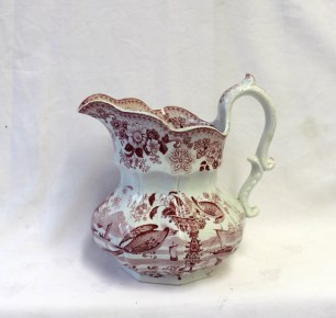 A Swansea Cambrian pottery pouch shaped baluster jug transfer decorated in reds with birds and a vase of flowers in the foreground and ships beyond, 'Cymro stone china' shield shaped mark to the base, 19cm high. Sold for £85 at Anthemion Auctions