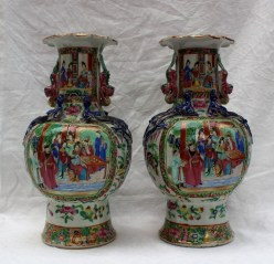 A pair of Cantonese porcelain vases, with a flared rim, applied with dogs of foo, balls and dragons, painted with interior scenes, on a spreading foot, 34cm high . Sold for £420 at Anthemion Auctions