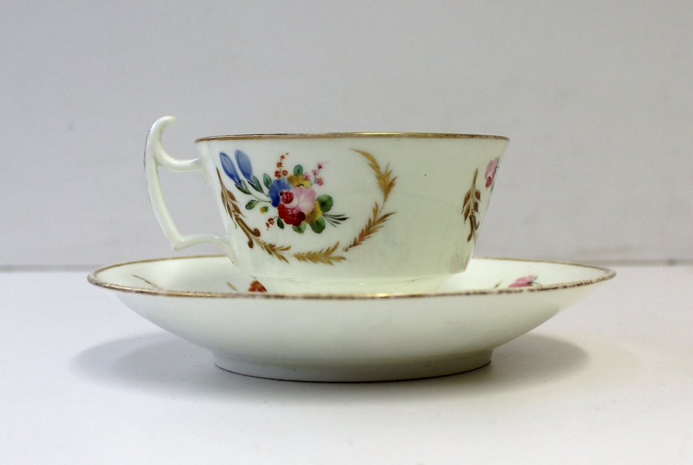 A Swansea porcelain tea cup and saucer painted with sprays of garden flowers within gilt wreaths, script mark to the base of the tea cup. Sold for £220 at Anthemion Auctions
