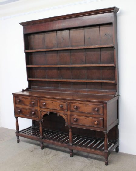 An 18th century South Wales oak dresser, the moulded cornice above three shelves. Sold for £800 at Anthemion Auctions