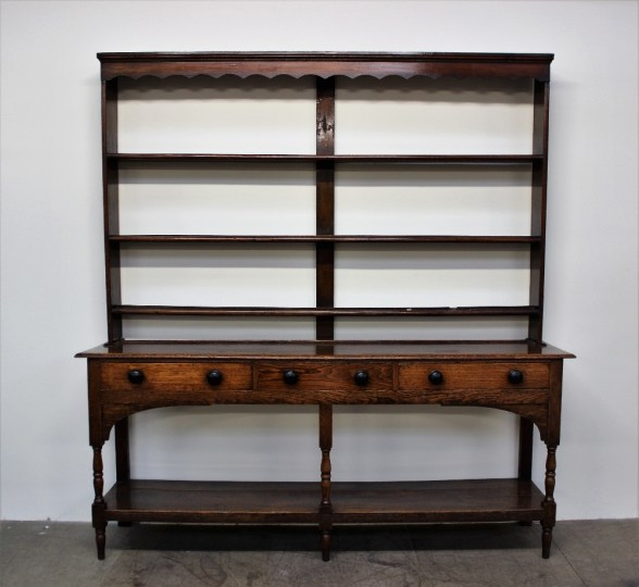 An 18th century South Wales oak dresser, the rack with a moulded cornice above a set of three open shelves. Sold for £400 at Anthemion Auctions