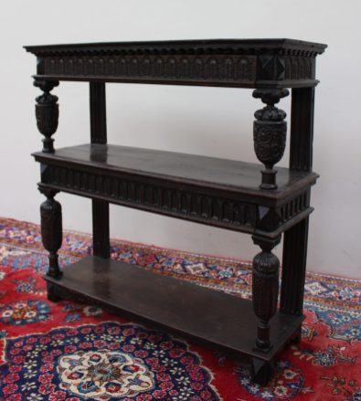 Lot 407 - Sold for £1,800 - A 17th century and later oak three tier buffet, the rectangular moulded top above a carved frieze drawer, the central shelf with a carved drawer front and an undertier each section held aloft by carved cup and cover supports, 114.5cm wide x 112.5cm high x 38cm deep