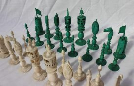 Lot 485 - Sold for £1,800 - A 19th century Anglo Indian ivory chess set, one side natural, the other stained green, carved with flowers, leaves and beading, King 12cm high, pawn 6.5cm high
