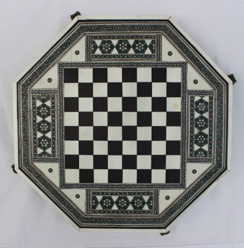 A 19th century Indian ivory, ebony and sadeli work chess board of octagonal form, on four gilt metal feet, 27.5cm wide. Sold for £200 at Anthemion Auctions