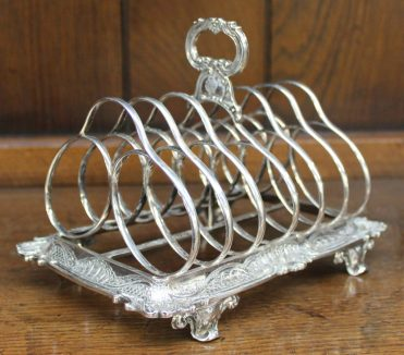 A Victorian silver toast rack, with six divisions, the base with a shell and C scroll border, on leaf scrolling feet, possibly George Ivory, London, 1846, approximately 375 grams, 17.5cm wide x 11.5cm deep x 113.5cm high. Sold for £300 at Anthemion Auctions