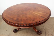 A Victorian rosewood supper table, the circular top with a gadrooned edge on a leaf carved column and leaf carved legs with claw and ball feet, 143cm diameter x 74cm high. Sold for £1,300 at Anthemion Auctions