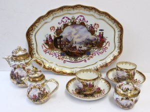 A Meissen cabaret set comprising; coffee pot, creamer and sucriere, the lids with rose bud finials, a pair of cups and saucers and a shaped oval tray, painted with shipping scenes in gilt vignettes with oriental style figures, underglazed crossed swords with cancellation mark and over glaze gilt B. Sold for £900 at Anthemion Auctions
