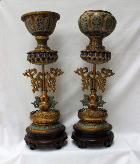 A matched pair of Chinese Buddhistic gilt and enamel decorated altarpieces, with a gilt bowl inset with carved jade panels, above enamel lotus leaf body, scrolling leaf column, the base with a pierced and lotus blossom base, 43cm high. Sold for £11,500 at Anthemion Auctions