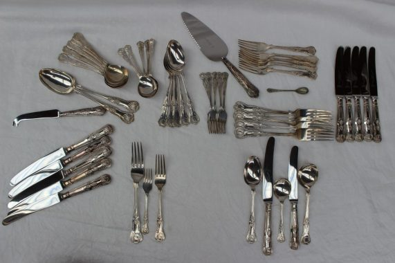 An Elizabeth II silver kings pattern flatware service, comprising a silver handled cake slice, six silver handled table knives, six cake spoons, six forks, six table forks, silver handled cheese knife, six silver soup spoons, six dessert spoons, six dessert forks, two silver table spoons and six silver handled silver side knives, weighable silver, Sheffield, 1970, 1971, approximately 2100 grams. Sold for £800 at Anthemion Auctions