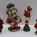 """A John Hughes pottery Grogg """"Tight Head Thomas"""" 12.5 cm high together with another of Gareth Edwards, a resin grogg of a Welsh dragon and another figure. Sold for £110 at Anthemion Auctions"""