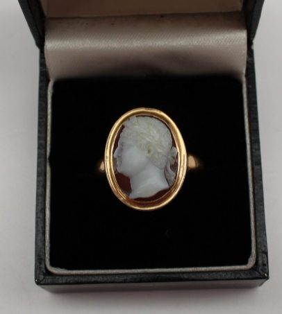 A shell cameo ring depicting a classical male portrait in profile in a yellow metal rubbed over setting and shank. Sold for £1,050 at Anthemion Auctions