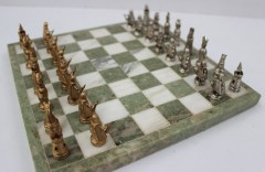A 9ct yellow and white gold chess set of conventional form, with a green and white marble board, cased, approximately 261 grams. Sold for £1,900 at Anthemion Auctions