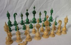 A 19th century Anglo Indian carved ivory chess set, natural and stained green, the Kings and Queens with fluted melon shaped crowns, pointed baluster pawns, King 11cm high, Pawns, 5.6cm high cancellation. Sold for £2,200 at Anthemion Auctions