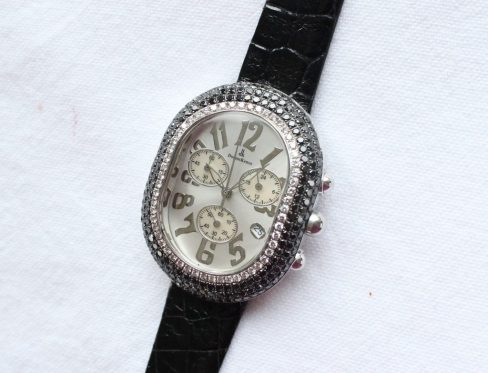 A Lady's Domoskenos wristwatch, the oval dial with Arabic numerals, and three subsidiary dials, surrounded by white and black diamonds to a stainless steel and leather strap, overall approximately 40mm x 35mm. Estimates of £200 - 300