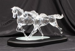 "A Swarovski crystal figure group titled ""The Wild Horses"" limited edition no. 05942/10000, in original fitted box with plinth, framed and glazed certificate, gloves, polishing cloth etc. Sold for £1,500 at Anthemion Auctions"