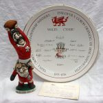 """A John Hughes grogg titled """"Under every great lock......Theres a good prop"""", signed to the underside and dated 1989, 27.5cm high, together with a Ra pottery Ltd """"The Grand Slam Commemorative Bowl, a Garrick Ward design, Bowl number: 222, 32.5cm diameter, with a certificate. Sold for £160 at Anthemion Auctions"""