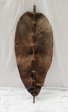 An African hide shield of oval form, mounted onto a wooden stake, possibly crocodile, overall length 113cm together with a fishing spear and another spear. Sold for £280 at Anthemion Auctions