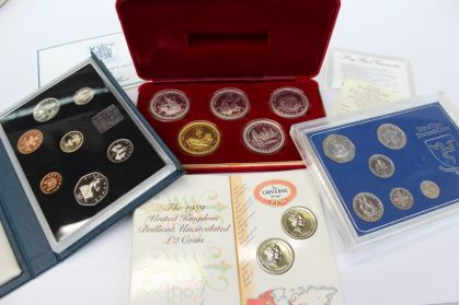 A set of five silver millennium crowns issued by the Isle of Man Government to commemorate the 1000 anniversary of Tynwald, 1979 together with a United Kingdom proof coin collection 1985, an Isle of Man 1975 Sterling Silver decimal coin set and the 1989 United Kingdom Brilliant Uncirculated £2 coins Sold for £75 at Anthemion Auctions