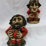 "A John Hughes Grogg, titled ""Gareth Owen Edwards"" in a Welsh rugby shirt with No.9 to the reverse, inscribed ""John Hughes Wales, 1977"" faint Gareth Edwards signature to the base, 24.5cm high together with a pottery wall plaque of a rugby player, 33cm high. Sold for £280 at Anthemion Auctions"