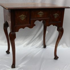 An 18th Century walnut lowboy, the rectangular top above three drawers and a shaped apron on cabriole legs and pad feet, 69cm wide x 47cm deep x 68.5cm high. Sold for £900 at Anthemion Auctions