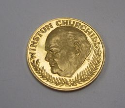 "A yellow metal coin produced to commemorate Winston Churchill with a portrait to one side and ""In memoriam 1874-1965"" to the other approximately 10grams Sold for £200 at Anthemion Auctions"