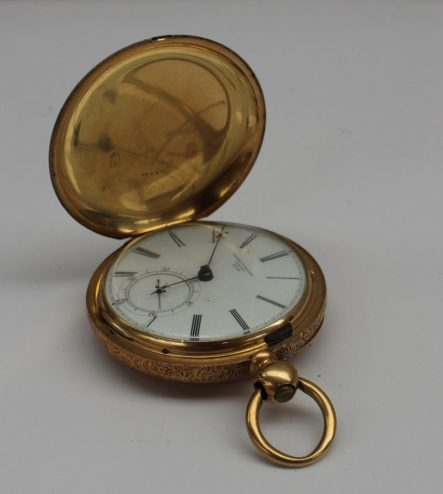"A yellow metal Hunter pocket watch, the case engraved with stars and scrolls, the case marked ""LB, 18K"", the enamel dial with Roman numerals and a seconds subsidiary dial inscribed ""James Stoddart, London, 47701"", the dust cover and back plate similarly marked. Sold for £1,100 at Anthemion Auctions"