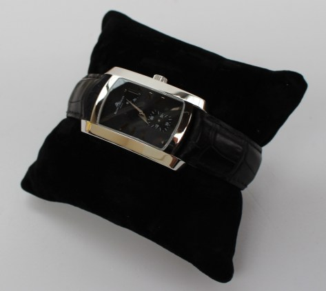 A Baume & Mercier gentleman's 18ct white gold wristwatch, No.3280523, the twin rectangular screw down case with polished side, the black dial and up-down power reserve indicator, on a faux crocodile strap with a Baume & Mercier 18ct white gold buckle, with a Baume & Mercier fitted box and 2003 Mappin and Webb invoice. Sold for £1,050 at Anthemion Auctions