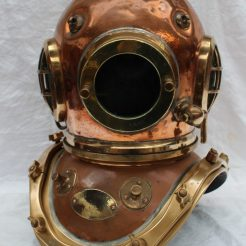 "A Siebe Gorman & Co Ltd twelve bolt copper divers helmet, stamped to the underside of the collar and matching on the helmet, No.17585 the glass front plate stamped 13063, with an oval plaque inscribed ""Siebe Gorman & Co. Ltd Submarine Engineers., London patent, 50cm high. Sold for £3,000 at Anthemion Auctions"