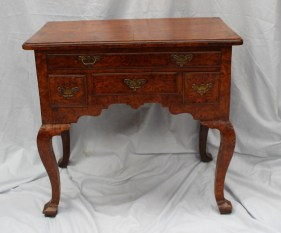 A George II walnut lowboy, the herringbone strung quarter veneered top above an arrangement of five drawers and a shaped apron on cabriole legs and pointed square feet, 78cm wide x 47cm deep. Sold for £2,500 at Anthemion Auctions