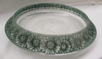 A Rene Lalique Marguerites pattern bowl, the rim decorated with interlocking daisy like flower heads with green decoration applied, stencil marked R Lalique, France to the base, 34.5cm diameter. Sold for £100 at Anthemion Auctions