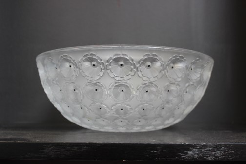 A Lalique Nemours pattern fruit bowl, with moulded decoration of flower heads, inscribed Lalique, France, 25.5cm diameter. Sold for £290 at Anthemion Auctions