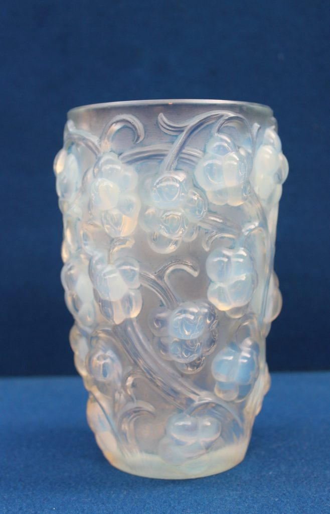 """A Rene Lalique """" Raisins"""" pattern vase thickly moulded with high relief grapes on vines motif around the exterior, marked to the base R Lalique, France, 15.8cm high. Sold for £700 at Anthemion Auctions"""