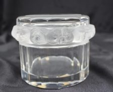 """A box and cover, the cover with raised decoration of birds, the panelled base marked """"Lalique France"""", 11cm diameter. Sold for £150 at Anthemion Auctions"""