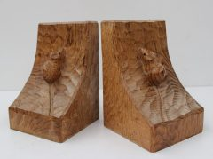 """A pair of Robert Thompson of Kilburn """"Mouseman"""" bookends, with trademark mouse on each one facing upwards 15.5 cm, high"""