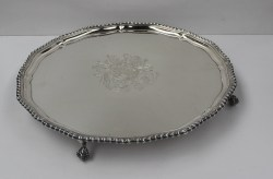 An Elizabeth II silver salver of circular form with a shaped gadrooned edge, engraved with a coat of arms to the centre, on four claw and ball feet, London, 1967, Wakely and Wheeler, 42cm Diam. approx. 1990 grams. Sold for £1,350 at Anthemion Auctions