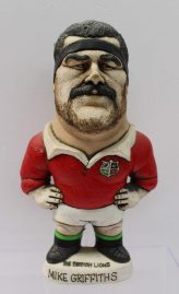 A John Hughes pottery Grogg of Mike Griffiths, in a British Lions Jersey with the No.1 on the reverse, incised to the reverse, Great Britain 2 - Australia 1, 22cm high. Sold for £420 at Anthemion Auctions