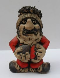 A John Hughes pottery Grogg of Gareth Edwards in a Welsh jersey, holding a ball, with the No.9 on the reverse, signed and dated 22/1/77 to the base, 22cm high together with another incised 'The Best Player...' 19.5cm high. Sold for £170 at Anthemion Auctions