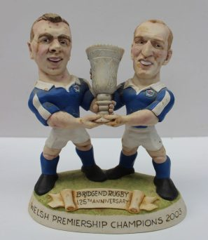 A limited edition World of Groggs figure group, No.39/125 'Bridgend Rugby 125th Anniversary, Welsh Premiership Champions 2003', 18cm high with certificate