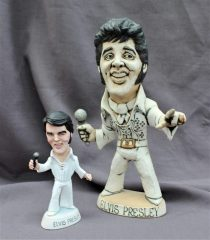 A John Hughes pottery Grogg of Elvis Presley, in white suit holding a microphone, signed to the base, 29.5cm high together with a World of Groggs Richard Hughes limited edition model of Elvis, No.257/300, 16cm high. Sold for £150 at Anthemion Auctions
