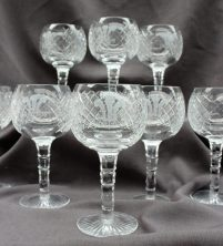 A set of eight Royal Irish Waterford crystal wine glasses, each engraved with the Prince of Wales feathers, with a panelled stem on a spreading foot, 19cm high. Sold for £150 at Anthemion Auctions
