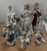 A Royal Worcester figure in celebration of The Queen's 80th Birthday together with a collection of Lladro and Nao figures