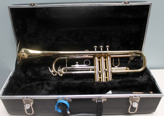 A Conn brass trumpet, cased
