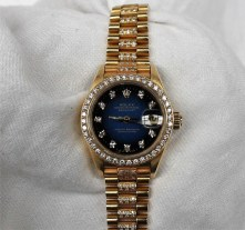 A Lady's 18ct yellow gold diamond set Rolex oyster perpetual datejust wristwatch, with a blue dial, diamond set markers, diamond set bezel and diamond set strap, overall approximately 69.7 grams, box, no papers. Sold for £5,000 at Anthemion Auctions